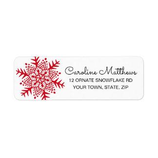 Étiquette Noël rouge de flocon de neige d'art populaire