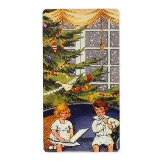 Étiquette Noël vintage, enfants s'asseyant sur un divan