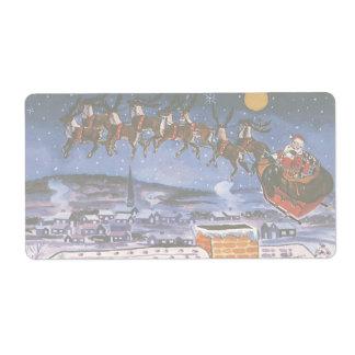 Étiquette Noël vintage le père noël pilotant son Sleigh