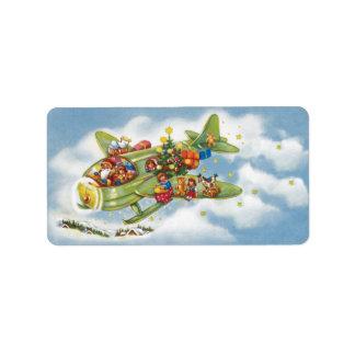 Étiquette Noël vintage, le père noël pilotant un avion