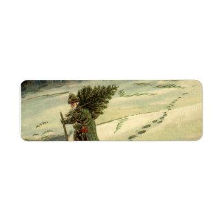Étiquette Noël vintage, le père noël portant un arbre