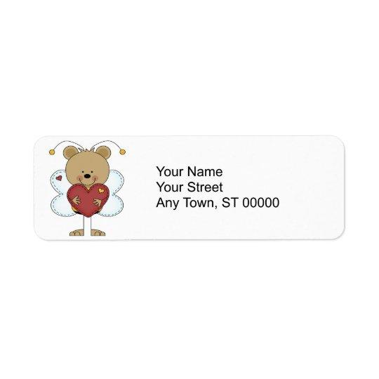 Étiquette petits adorables gaffent l'ours tenant un coeur
