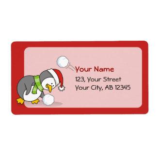 Étiquette Pingouin de Noël obtenant une boule de neige