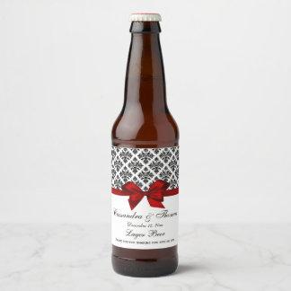 Étiquette rouge de bouteille à bière de la damassé
