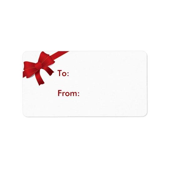 Étiquette rouge de cadeau de Noël d'arc