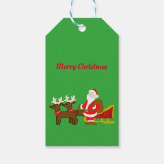 Étiquettes-cadeau le père noël sur le traîneau de Noël