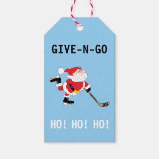 Étiquettes-cadeau Noël de patinage de Père Noël d'hockey donnent N