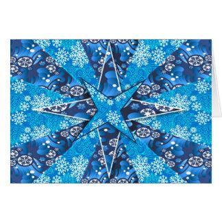 Étoiles bleues avec des flocons de neige sur la carte de vœux