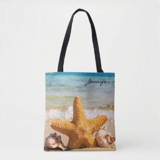 Étoiles de mer et coquillages sur la plage tote bag