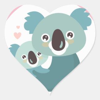 Étreindre doux de mère et de bébé de koala de sticker cœur