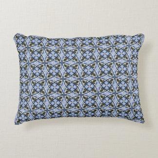 Évaluez une conception bleue de motif de coussin