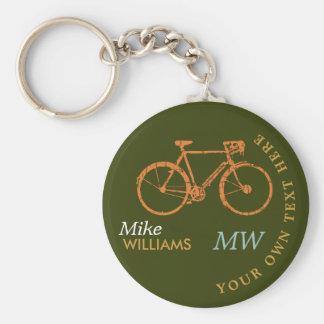 faire du vélo, a.bike sur le porte - clé verdâtre porte-clé rond