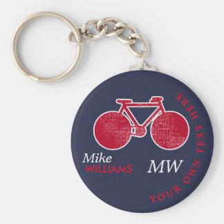 faisant du vélo, vélo rouge sur le porte - clé porte-clé rond