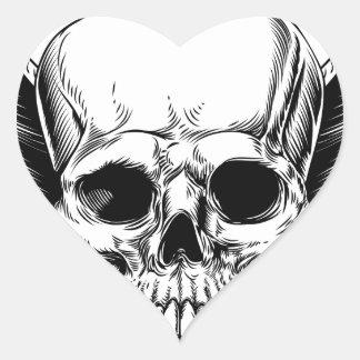 Faucheuse à ailes de crâne sticker cœur