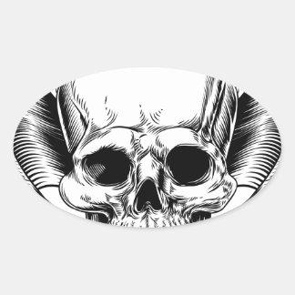 Faucheuse à ailes de crâne sticker ovale