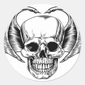 Faucheuse à ailes de crâne sticker rond