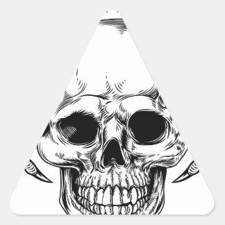 Faucheuse à ailes de crâne sticker triangulaire
