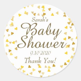 Faveur d'or de baby shower de coeurs sticker rond