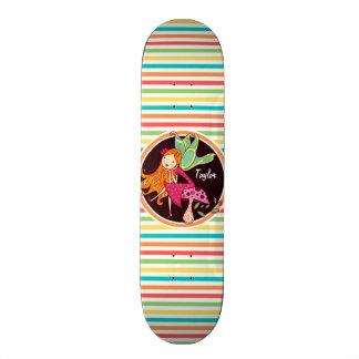 Fée sur les rayures lumineuses d'arc-en-ciel plateaux de skateboards