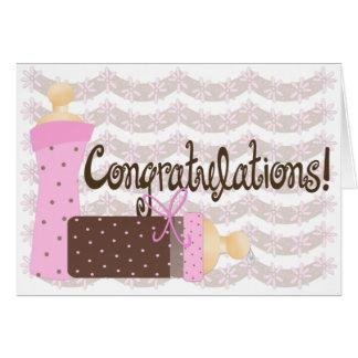 Félicitations de rose et de bébé de bouteilles de carte de vœux
