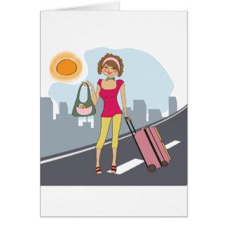 Femme avec une valise carte de vœux
