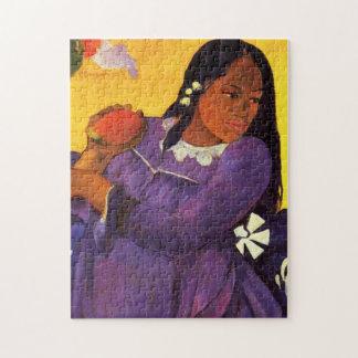 Femme de Gauguin avec un puzzle de mangue