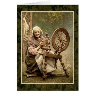 Femme irlandaise avec sa roue de rotation carte de vœux