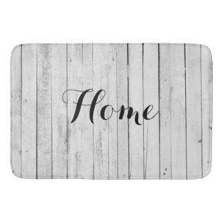 Ferme en bois noire et blanche à la maison tapis de bain