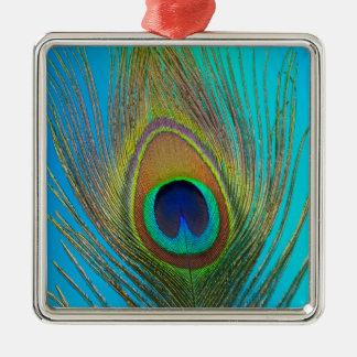 Fermez-vous de la plume de paon ornement carré argenté