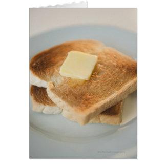 Fermez-vous des pains grillés avec du beurre du carte de vœux