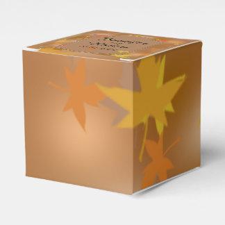 Feuille d'automne d'orange et de jaune épousant le ballotin pour dragées