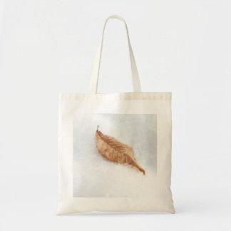 Feuille de hêtre dans une dérive de neige sac