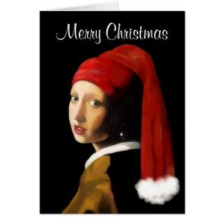 Fille avec la carte de Noël de boucle d'oreille de
