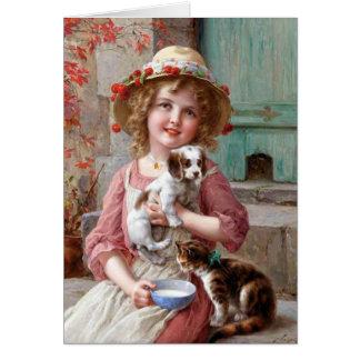 Fille avec la carte de voeux de chiot et de chaton
