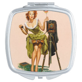 Fille vintage de pin-up d'appareil-photo miroir de poche