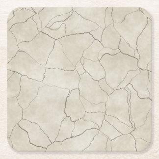 Fissures sur l'arrière - plan texturisé beige dessous-de-verre carré en papier