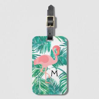 flamant rose de monogramme sur le feuille tropical étiquette à bagage