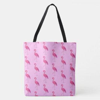 Flamants assez roses sur un arrière - plan rose sac