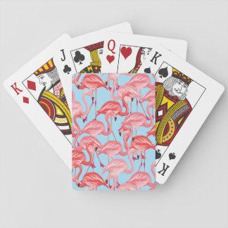Flamants roses lumineux sur le bleu jeu de cartes