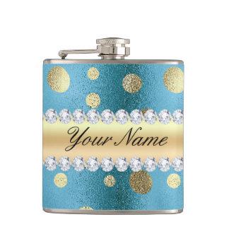 Flasques Taches de feuille d'or de Faux sur le bleu