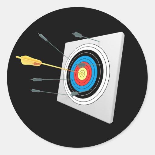 Flèche d'or dans une cible autocollants ronds