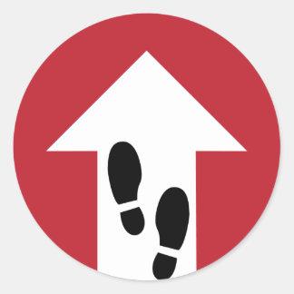 Flèche en avant avec l'autocollant directionnel sticker rond