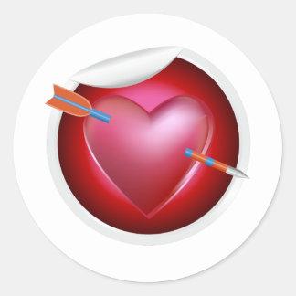 Flèche par le coeur sticker rond