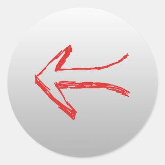Flèche se dirigeant à gauche. Sur le gris Sticker Rond