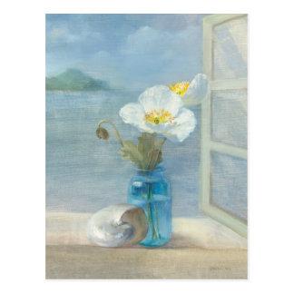Fleur blanche donnant sur la mer carte postale