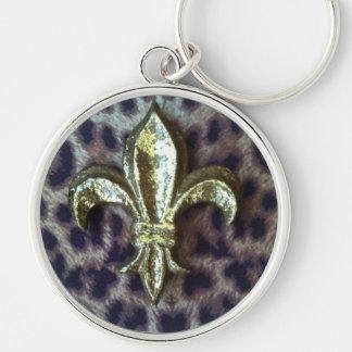 Fleur de lis sur le porte - clé de léopard porte-clé rond argenté