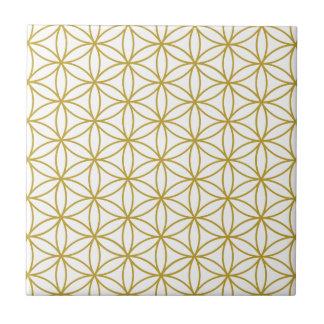 Fleur du motif de la vie - or sur le blanc carreau