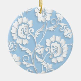Fleurs blanches sur des bleus layette ornement rond en céramique