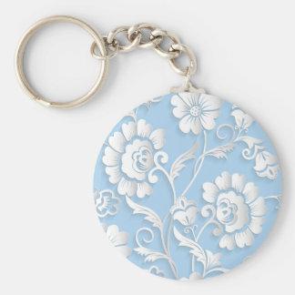 Fleurs blanches sur des bleus layette porte-clé rond