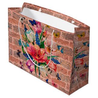Fleurs colorées chics sur le mur de briques grand sac cadeau